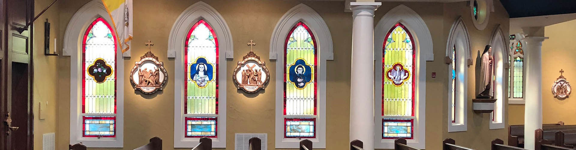 large beautiful banner image of St. John's stained glass windows